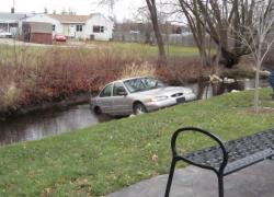 Car rolls into Cedar Creek