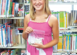 Sixth grader raises money for library