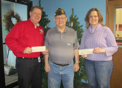 American Legion presents checks