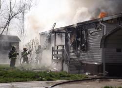 Mobile home burns