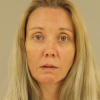 Woman charged in man's death