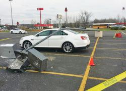 Pole falls on car
