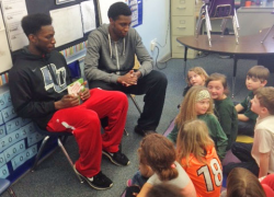Davenport Basketball Players Read with Students for Reading Month
