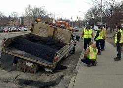 Pothole repair truck falls into pothole