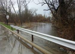 Cedar Creek floods roadways, yards