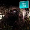 Car drives into Pine Lake