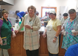 Women's Club and Rotariansassists with community meal