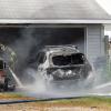 Lawn mower starts car on fire