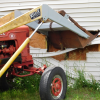 Runaway tractor plows into house