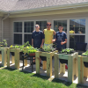 Students build plant stands for elderly
