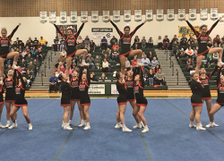 Cheer teams victorious on the mat