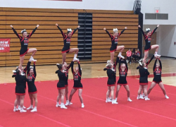 Cheer team takes first at Lowell
