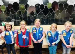 Girls Scouts donate cookies to senior citizens