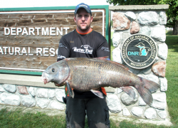 Angler catches state record black buffalo