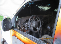 Police officer discovers burning vehicle