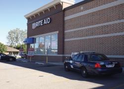 Rite Aid robber threatens clerk