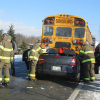 Car rear-ends school bus