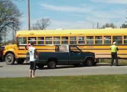 Pickup runs into school bus