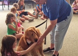 Girl Scouts donate to Paws with a Cause