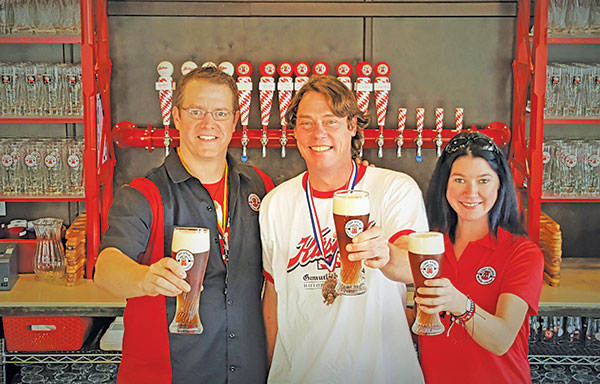 Celebrating at Cedar Springs Brewing Company, from left, David Ringler, Matt Peterson, Manda Geiger.