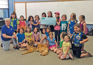 Local Girl Scouts help Paws with a Cause.