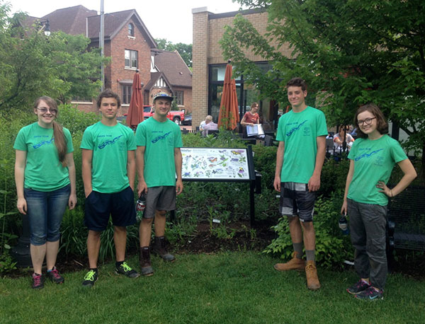 From left to right: Intern DeAnna Clum, students Liam Gardner, James Olsen, Max Homrich and Claire Gault visiting a garden in Grand Rapids.