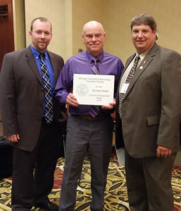 Mike Waite (center) received the Lifetime Achievement Award at the MITES state convention on May 13. Courtesy photo.