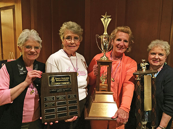 Area Grand Rapids Sweet Adelines members celebrating wins at Sweet Adelines Region 17 Competition in Cleveland:  (l-r) Margaret Durga and Judie Wabeke from Greenville; Mary Myers from Rockford; and Sue Harrison from Cedar Springs.