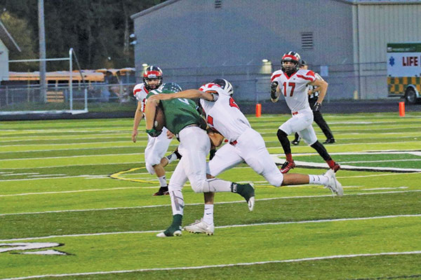 A Red Hawk tackles a Ranger during last Friday night's loss to Forest Hills Central. Photo by K. Alvesteffer/R. LaLone.