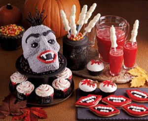 Clockwise from upper left: Vicious-Delicious Vampire Cake, Freaky Fingers Candy Straws, Freaky Fingers Strawberry Cooler, Fright Nite Cupcakes, Vampire Fang Cookies and Vampire's Bite Cupcakes