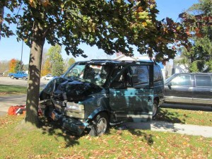 This van slammed into a tree in the Springs Church parking lot Monday. Post photo by J. Reed.