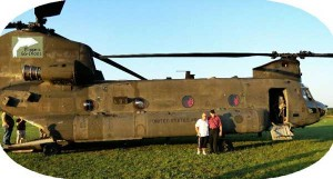 Wayne and June Price are shown in front of a Chinook helicopter.