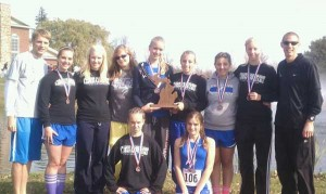 "The CTA girls cross country team took second place in Class ""D"" Cross Country Coaches Association Championships last Saturday. Standing (L to R): Coach Aaron Kenemer, Dani George, Esther Hubbard, Olivia Wortz, Grace VanEnk, Alicia Beck, Mikayla Tomandl, Hannah Hubbard, Coach Gerry Verwey.  Kneeling (L to R): Michaela Smith, Erin Munger."