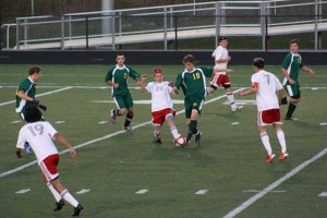 #20 Jon Shaw challenges for the ball vs. Comstock Park. Also pictured are #7 Aaron Dault, #17 Luke Dault, #19 Ilan Caballero.