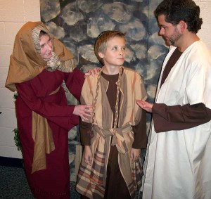 The Rogue River Community Theatre will perform The Light of Heaven's Dove at the Kent Theatre Nov. 17-19. Pictured left to right are Teresa Lautenbach as Mary, Hunter Simon as Boy Jesus, and PJ Bevelacqua as Joseph.