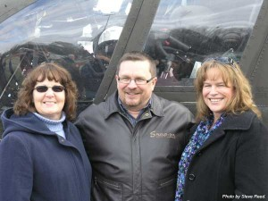 Jack Price Jr.and his wife Patty (left) with sister Dawn standing in front of the Chinook Helicopter last Friday.