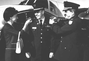 2nd Lt. Jack Price, center, gets his wings.