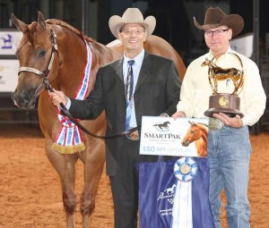 Frank Berris, of Sparta (R), with the trophy and his horse, Obviously OT. On the left is Charlie Hemphill, AQHA Sr. Director of Shows. Photo courtesy of The American Quarter Horse Journal.