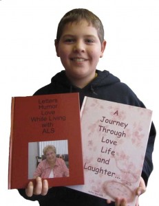 Evan Galle, 11, is shown here with the books that contain the writings of his late grandmother, Kris Galle. Evan is her youngest grandson. Post photo by J. Reed.