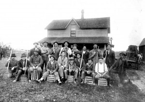"""Modern"" Woodmen lodge members help an ill neighbor (Burch), in potato harvesting at Solon Center, circa 1915. Back row (L to R): Charley Terrell, Walter Spathe, Emmory Goodell, Alvin Heiss Sr., Guy Eyers, Ray Bloomfield, Sherm Smith. Front row (L to R): Chauncey Weller, unknown, Berny Goodell, Ira Goodell or Gerald Bloomfield, Morgan Smith, Glenn Heiss, Ernest Weller, Denny Noonen, Alvin Heiss, Jim Bloomfield."