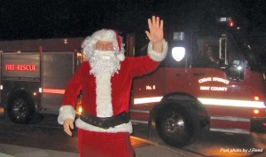 Santa hitches a ride from the Cedar Springs Fire Department to the tree lighting event.