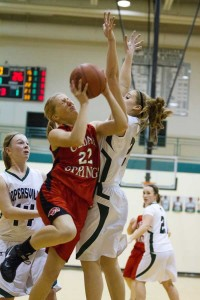 #22 Allie Veltkamp driving hard to the basket