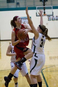#33 Tiffany Karger driving hard in for a layup
