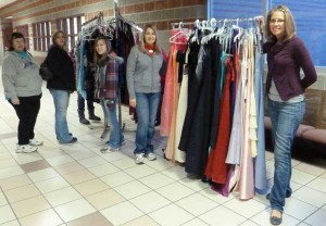 The used gown sale fundraiser earned money toward the library match challenge Saturday.