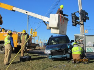 Utility workers working on a pole damaged in an accident at 17 Mile and White Creek Avenue Tuesday. Post photo by J. Reed.