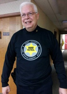 Cedar Springs Police Chief Roger Parent modeling the Kent County Law Enforcement t-shirt.
