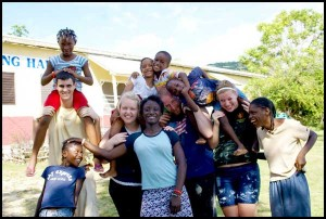 Rachel Hunt (left center), her husband, Josh (right center), and other members of the Jamaica mission team and friends.