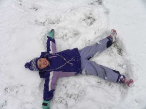 Johanna Nederhood, 4, the daughter of Tom and Monica Nederhood of Cedar Springs, is having fun making a snow angel.