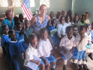 TAFU founder Mary Fournier poses with students and teacher of a kindergarten class in Uganda. Through the generosity of people in west Michigan, this needy school has been able to triple in size and educate hundreds more students.