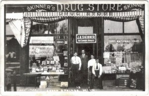 Skinner's Drug Store about 1900. Bert Skinner is in the suit, with his wife, and pharmacists Charles Maynard and Mr. Doyle.
